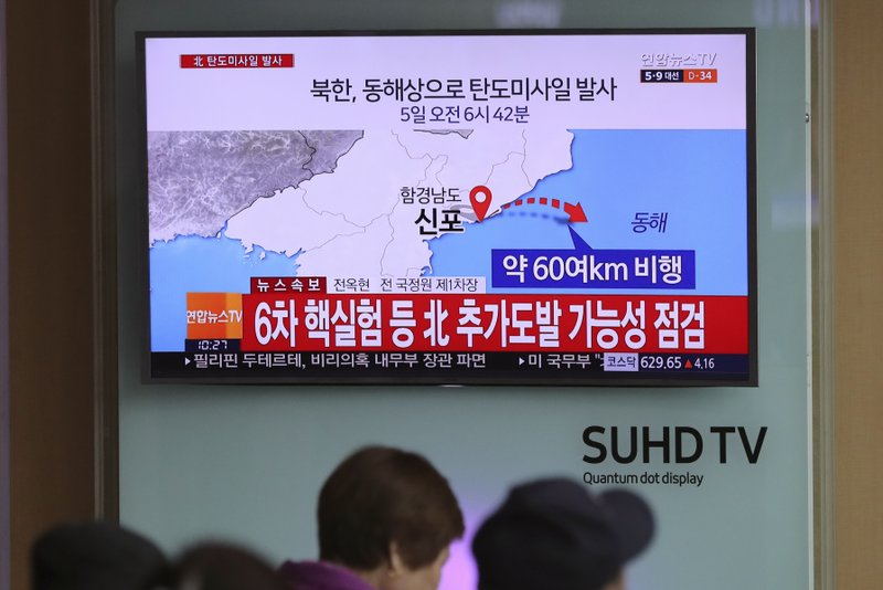 """Visitors sit in front of the TV screen showing a news program reporting about North Korea's missile firing, at Seoul Train Station in Seoul, South Korea, Wednesday, April 5, 2017. North Korea fired a ballistic missile into its eastern waters Wednesday, U.S. and South Korean officials said, amid worries the North might conduct banned nuclear or rocket tests ahead of the first summit between President Donald Trump and his Chinese counterpart Xi Jinping this week. The letters read """"North Korea fired a ballistic missile into its eastern waters."""""""