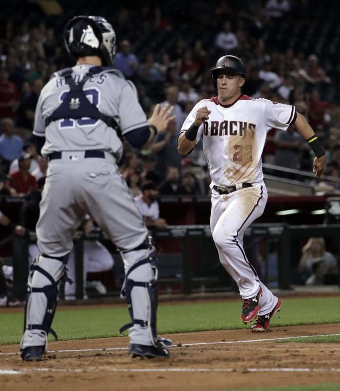 Arizona Diamondbacks' Jake Lamb scores on an RBI double as San Diego Padres catcher Austin Hedges waits for the throw during the fourth inning of a baseball game, Monday, April 24, 2017, in Phoenix. (AP Photo/Matt York)