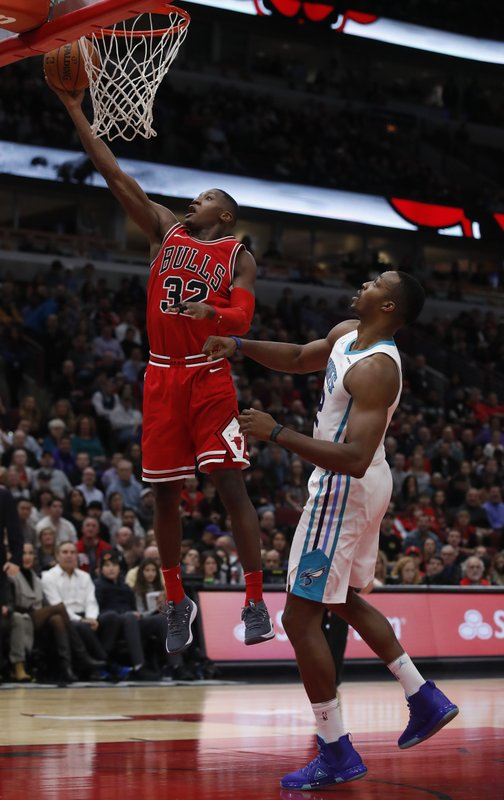 Kris Dunn, Dwight Howard