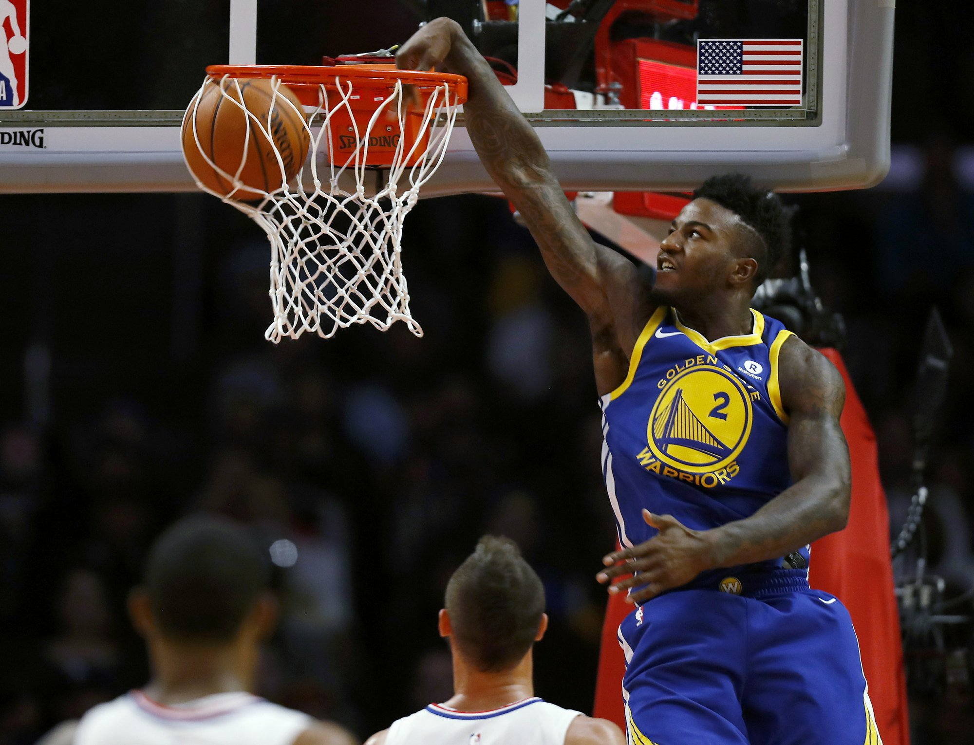 cd9fa2d09b41 Golden State Warriors forward Jordan Bell dunks the basketball during the first  half of an NBA basketball game against the Los Angeles Clippers