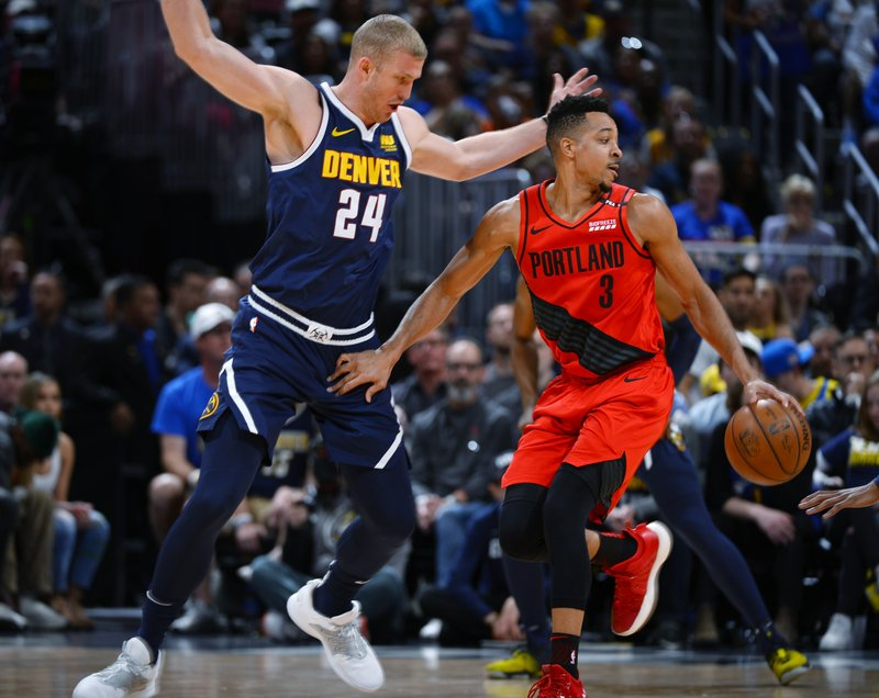 71e9a54ca4d CJ McCollum leads Blazers past Nuggets 100-96 in Game 7