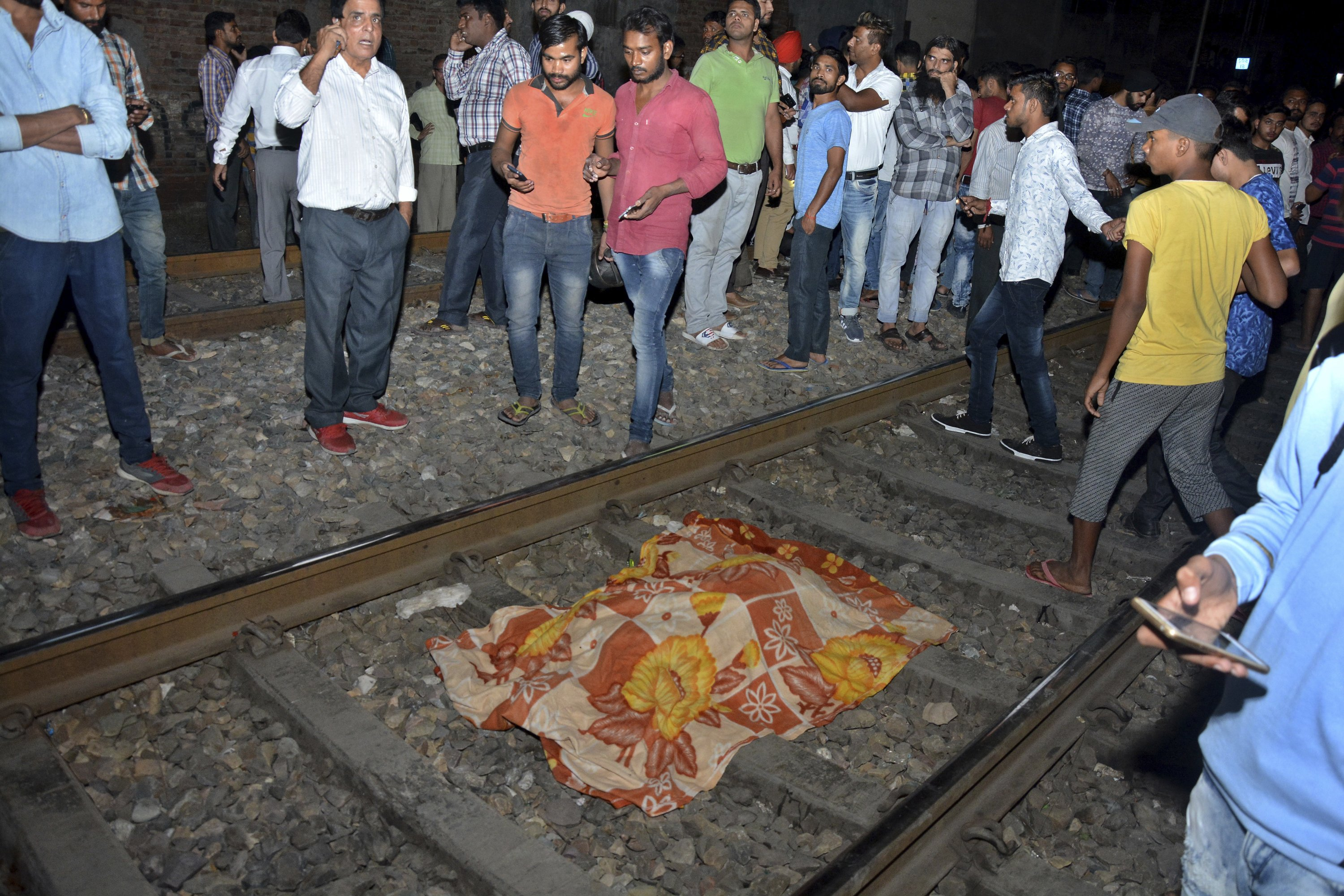 Train mows down crowd at India festival, at least 60 dead