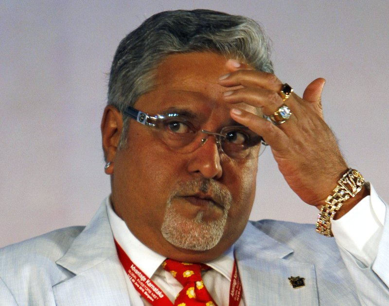 In this June 3, 2010 file photo, United Breweries Group Chairman Vijay Mallya attends the Global Investors Meet organized by Karnataka state government in Bangalore, India. India's top court on Tuesday, May 9, 2017, found wanted tycoon Mallya guilty of disobeying its order barring him from transferring $40 million to his children. Mallya, who fled to London last year, is wanted in India on charges of money laundering and bank demands that he pay back more than a billion dollars in loans extended to his now-defunct airline. India has been seeking his extradition over the charges, which Mallya denies.