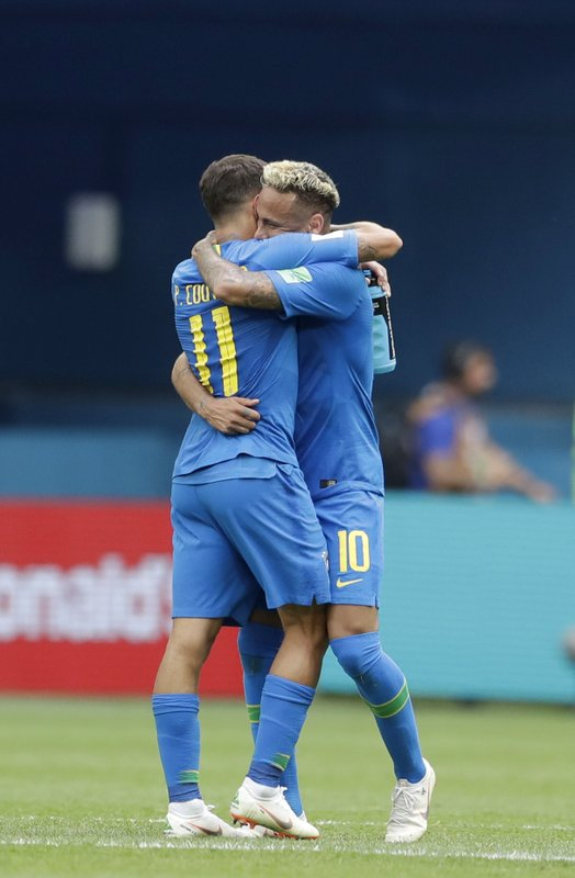 Brazil's Philippe Coutinho, left, hugs Neymar at the end of the group E match between Brazil and Costa Rica at the 2018 soccer World Cup in the St. Petersburg Stadium in St. Petersburg, Russia, Friday, June 22, 2018.
