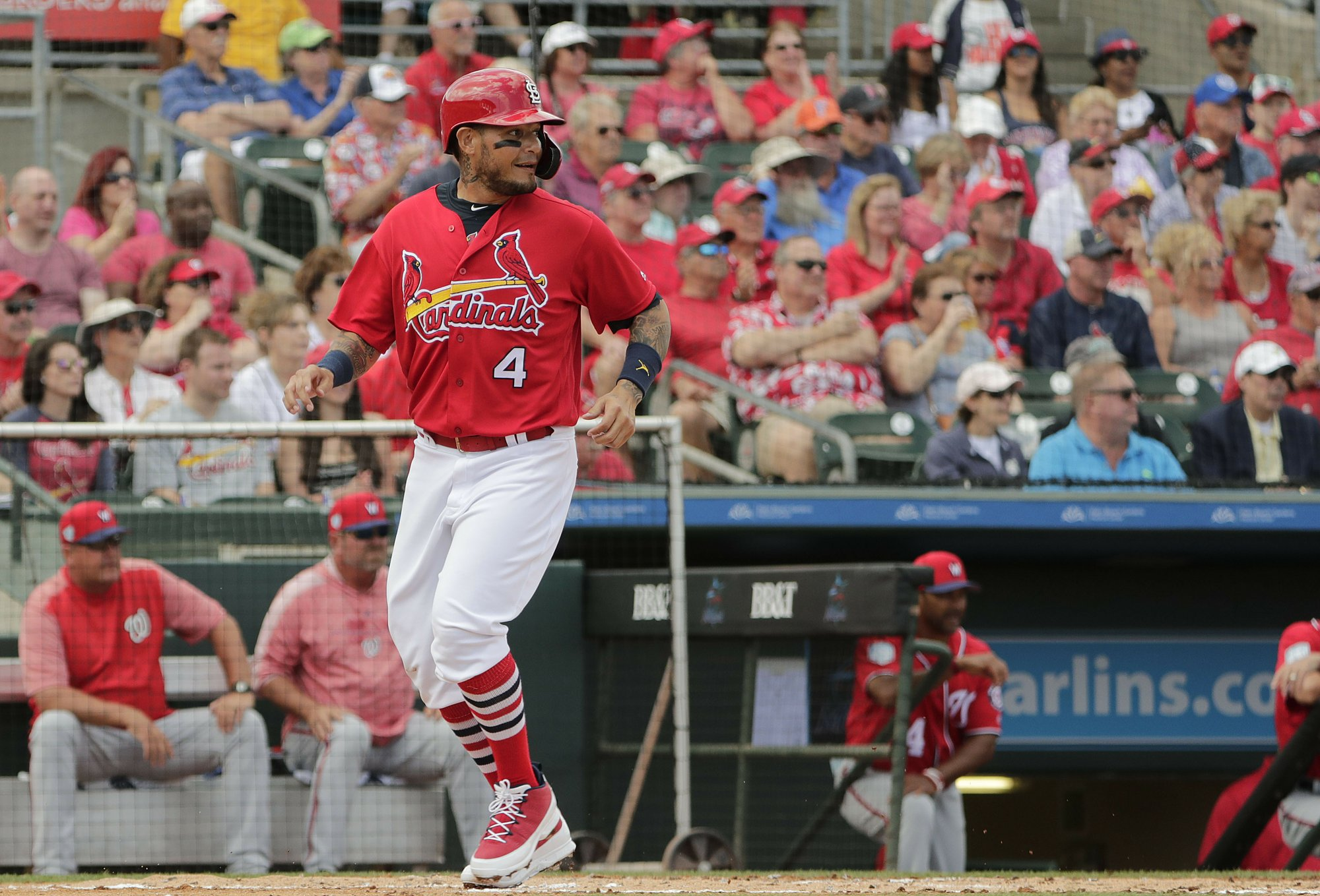 Cardinals' Yadier Molina singles in return from knee surgery