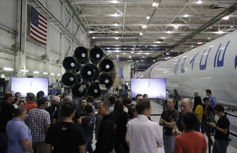 44fde11869 Employees wait before the start of an event with SpaceX founder and chief  executive Elon Musk to announce the name of the person who would be the  first ...