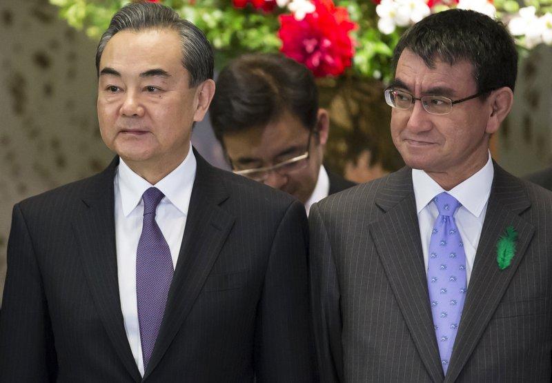 Wang Yi, Taro Kono