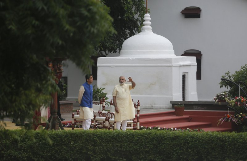 Indian Prime Minister Narendra Modi gestures as he speaks with Japanese Prime Minister Shinzo Abe at Sabarmati Ashram, or Gandhi Ashram, in Ahmadabad, India, Wednesday, Sept. 13, 2017. Abe is on a two-day official visit to India.