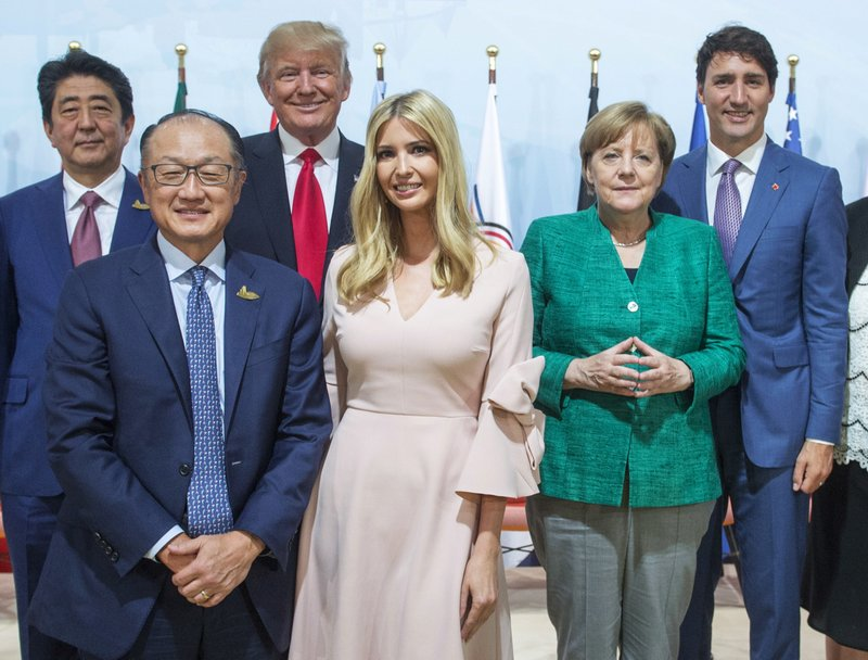 Japanese Prime Minister Shinzo Abe, left to right, World Bank President Jim Yong Kim, United States President Donald Trump, his daughter Ivanka Trump, German Chancellor Angela Merkel and Prime Minister Justin Trudeau pose for a photo after the Women and Development event at the G20 summit Saturday, July 8, 2017 in Hamburg, Germany.