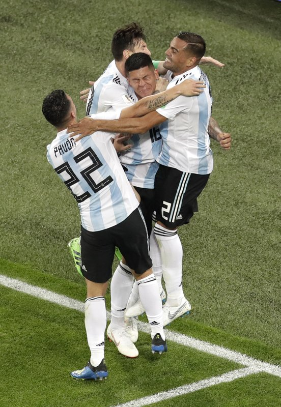 Argentina's Marcos Rojo, center, celebrates with teammate Lionel Messi after scoring his side's second goal during the group D match between Argentina and Nigeria, at the 2018 soccer World Cup in the St. Petersburg Stadium in St. Petersburg, Russia, Tuesday, June 26, 2018.