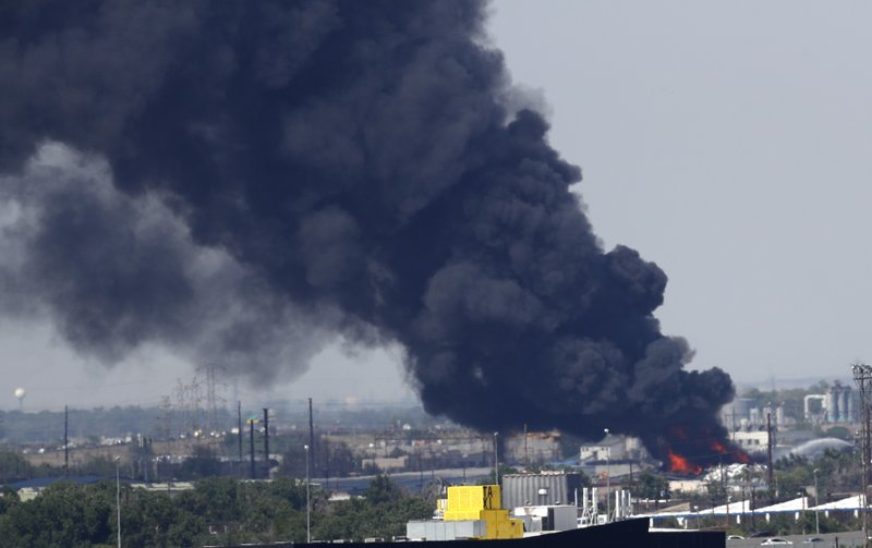 Smoke plume from fire in recycling yard