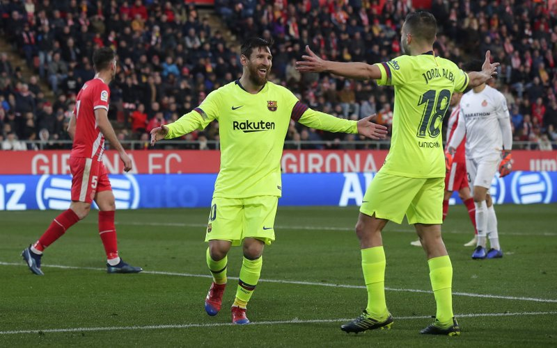 e8819a1b1 Messi scores as Barcelona wins 8th straight league game