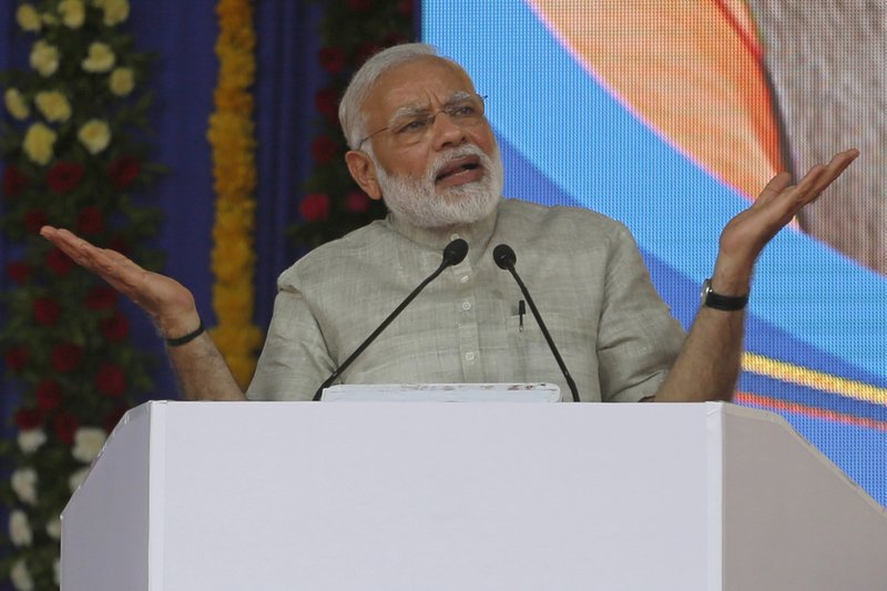 In this June 30, 2017, file photo, Indian Prime Minister Narendra Modi speaks at an event a day before the implementation of the nationwide Goods and Services Tax in Ahmadabad, India. Modi came to power on a euphoric wave of promises to boost the economy. Three years later, India's economic prospects are looking decidedly more grim. India's economic expansion has slowed to its lowest level in three years.