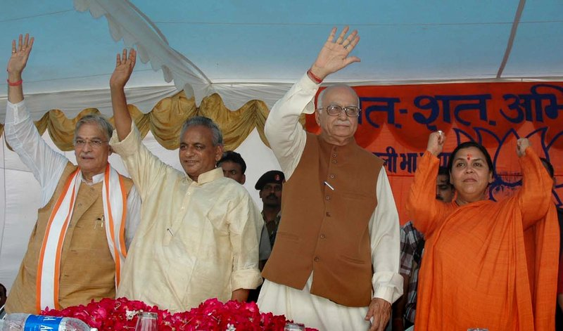 In this July 28, 2005 file photo, Indian opposition leader and President of the Bharatiya Janta Party (BJP) L.K. Advani, second right, senior BJP leaders Uma Bharati, right, Kalyan Singh, second left, and Murli Manohar Joshi wave to people during a public rally in Rae Bareilly, in the northern Indian state of Uttar Pradesh. India's top court said Wednesday, April 19, 2017, that the four senior leaders of India's ruling Hindu nationalist Bharatiya Janata Party will stand trial for their role in a criminal conspiracy over the destruction of the 16th century Babri mosque in 1992, an event that sparked bloody nationwide rioting. Of the four main leaders who will now stand trial, Singh is currently the governor of an Indian province, and the constitution protects him from criminal trial. Therefore his trial will start after his term ends.