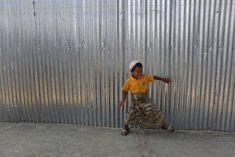 In this Sunday, Sept. 10, 2017, photo, a Rohingya boy plays outside a temporary shelter at a camp in Kathmandu, Nepal. Recent violence in Myanmar has driven hundreds of thousands of Rohingya Muslims to seek refuge across the border in Bangladesh. Only about 250 Rohingya live in Nepal since anti-Muslim riots erupted in Myanmar in 2012, according to the U.N. refugee agency, which offers them education and medical support. The refugees live in a ramshackle camp carved out on a slope on the outskirts of the capital, Kathmandu. Their huts of tin, bamboo and plastic sheets are connected by narrow stone steps.