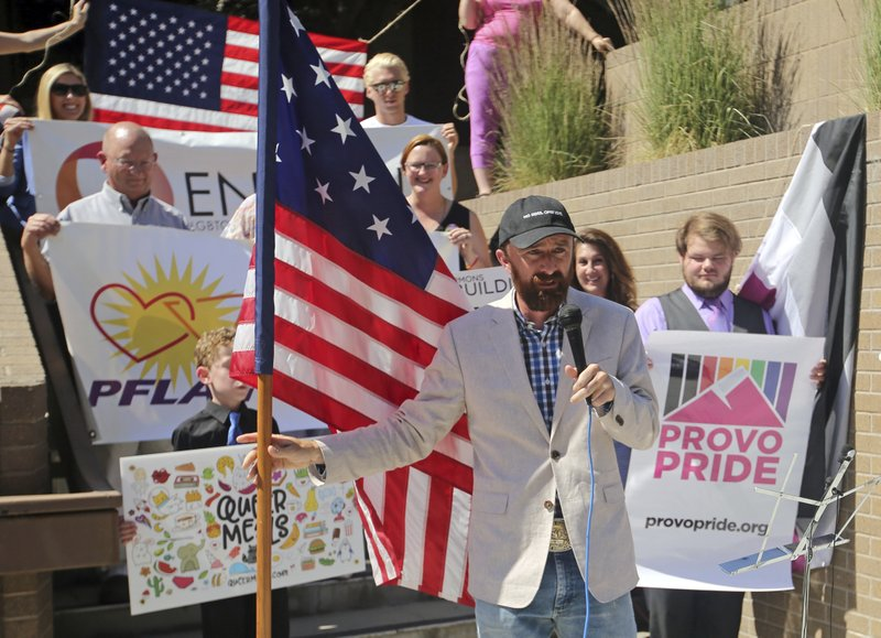 05beaa809ae ... as he holds the American flag during a news conference to discuss the  America s Freedom Festival s decision Thursday