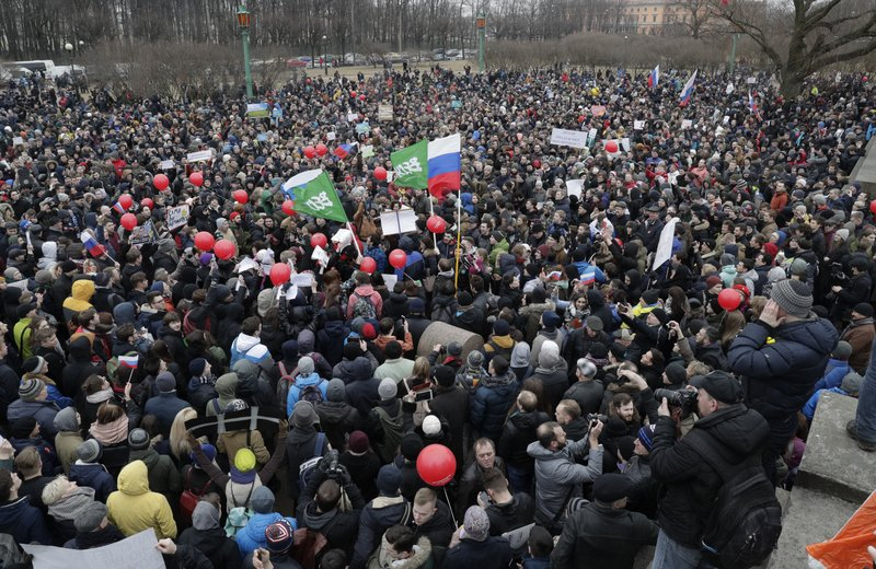 Protesters gather at Marsivo Field in St.Petersburg, Russia, Sunday, March 26, 2017. Thousands of people crowded in St.Petersburg on Sunday for an unsanctioned protest against the Russian government, the biggest gathering in a wave of nationwide protests that were the most extensive show of defiance in years.