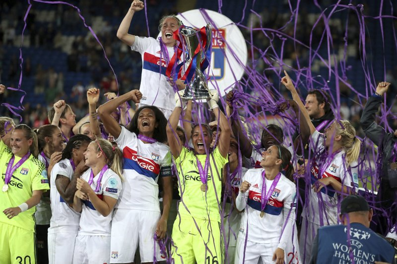 4b7157e76 Lyon s goalkeeper Sarah Bouhaddi lifts the trophy after the Women s  Champions League Final soccer match at the Cardiff City Stadium in Cardiff