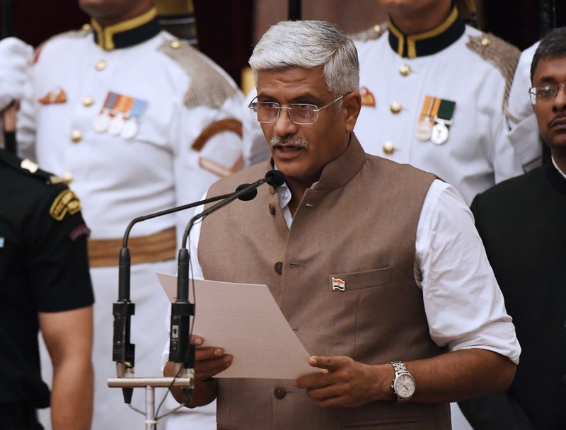 Bhartiya Janata Party (BJP) politician Gajendra Singh Shekhawat, takes the oath during the swearing-in ceremony of new ministers at the Presidential Palace in New Delhi, India, Sunday, Sept.3, 2017. India Prime Minister Narendra Modi, on Sunday reshuffled some of his key minister's portfolios to refurbish his government's image, which has been dented by falling economic indicators.