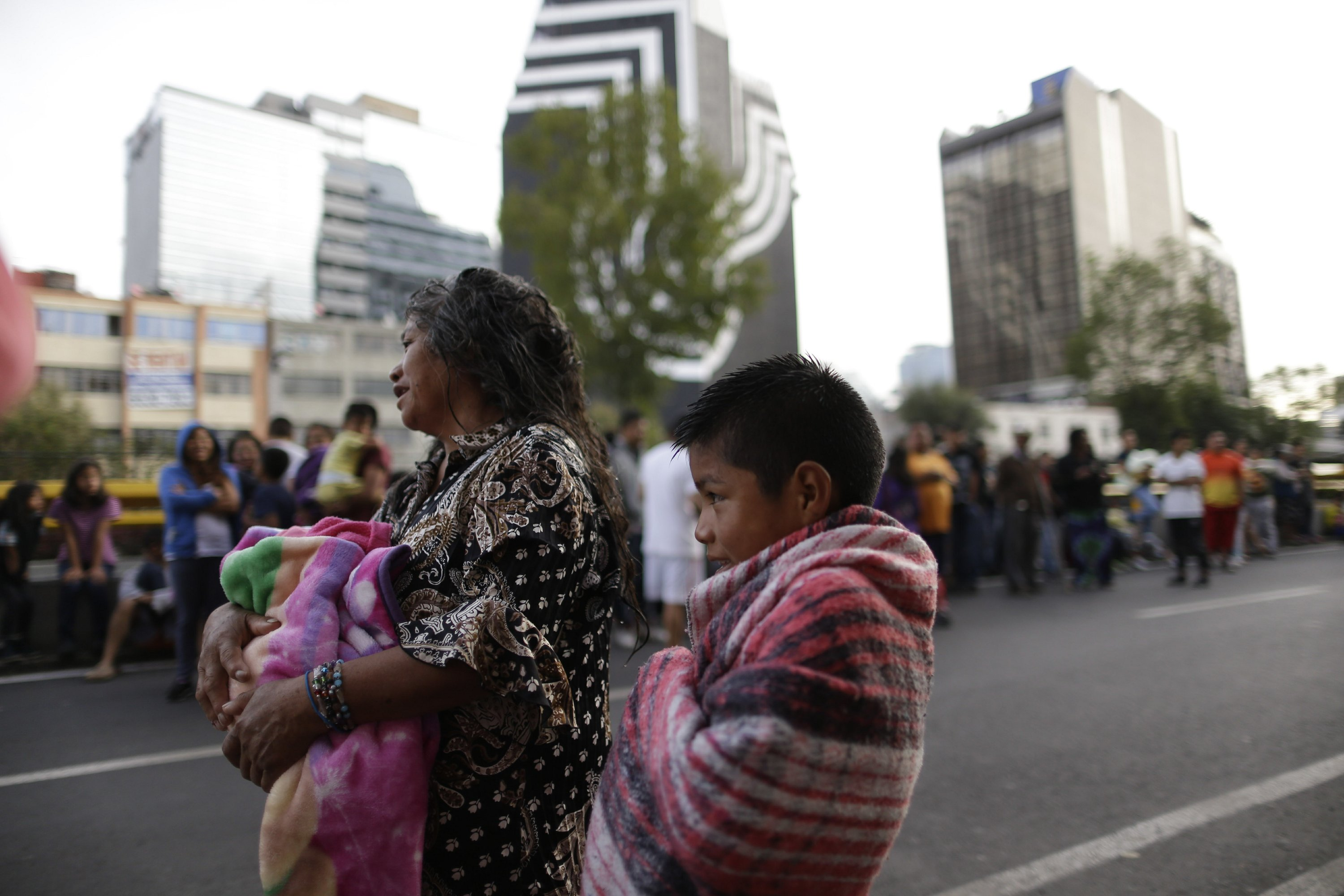 The Latest: After quakes, Mexico volcano spews vapor and ash