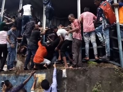A stampede broke out on a crowded pedestrian bridge connecting two railway stations in Mumbai during the Friday morning rush, killing at least 22 people and injuring another 32, officials said. (Sept. 29)