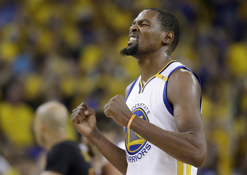 474a79e72 Golden State Warriors forward Kevin Durant reacts after scoring against the Cleveland  Cavaliers during the second half of Game 5 of basketball s NBA Finals ...