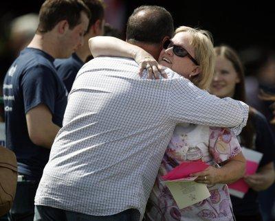 Columbine attendees hug, columbine attendees