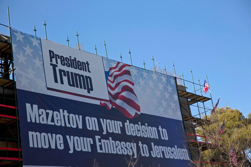 FILE   In This Jan. 20, 2017, File Photo, A Sign Hangs On A Building Under  Construction In Jerusalem. When The Stars And Stripes Are Hoisted Over The  New ...