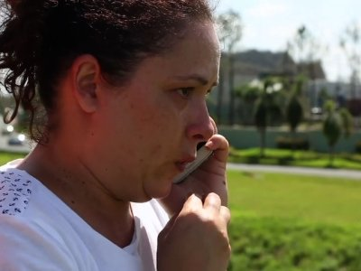 Puerto Ricans Try to Reach Relatives, Fly Out