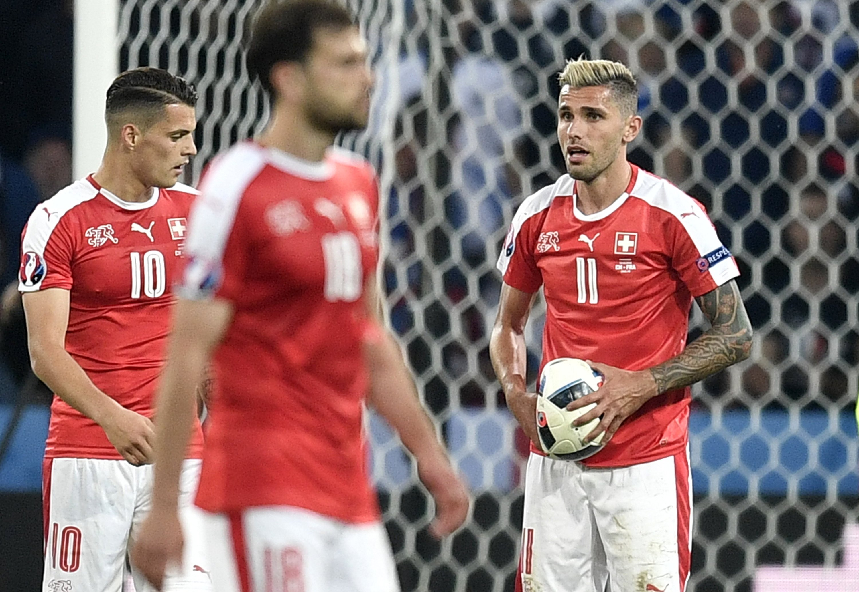 The Latest: Soccer ball splits open at Euro 2016