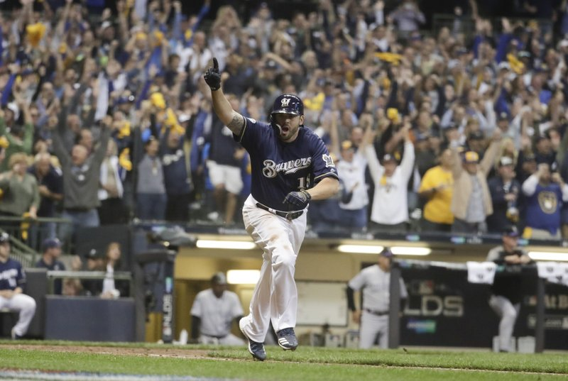 best service 356b5 50391 Moustakas scores Yelich in 10th, Brewers top Rox in opener