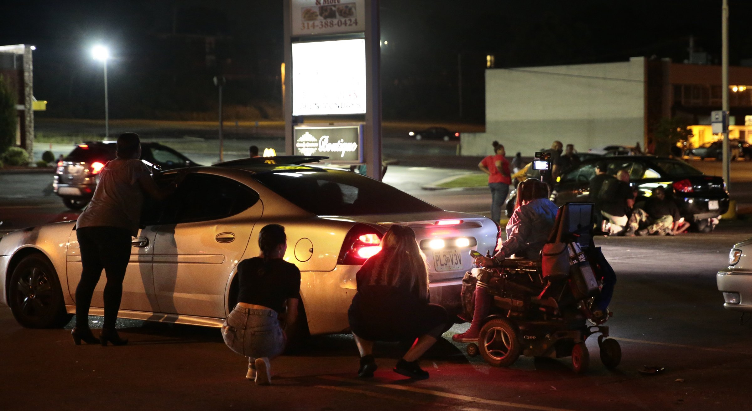Witnesses: Shots fired in Ferguson after car hits protester