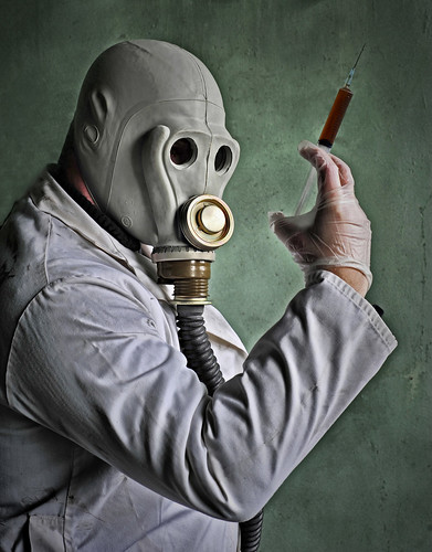 Lab assistant wearing a gas mask