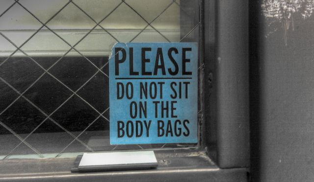 Please Don't Sit on the Body Bags