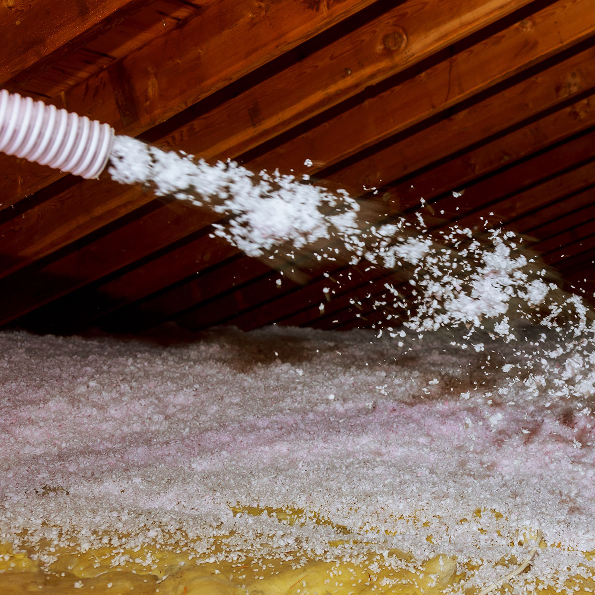 blowing insulation into an attic