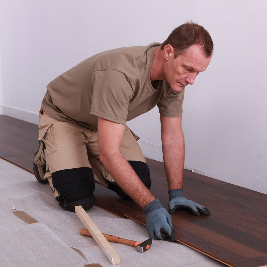 putting floor boards into place
