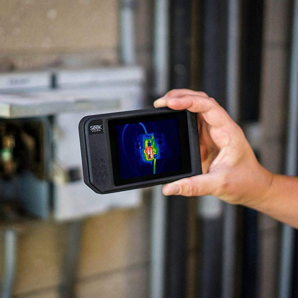 holding a thermal camera up to a junction electrical box