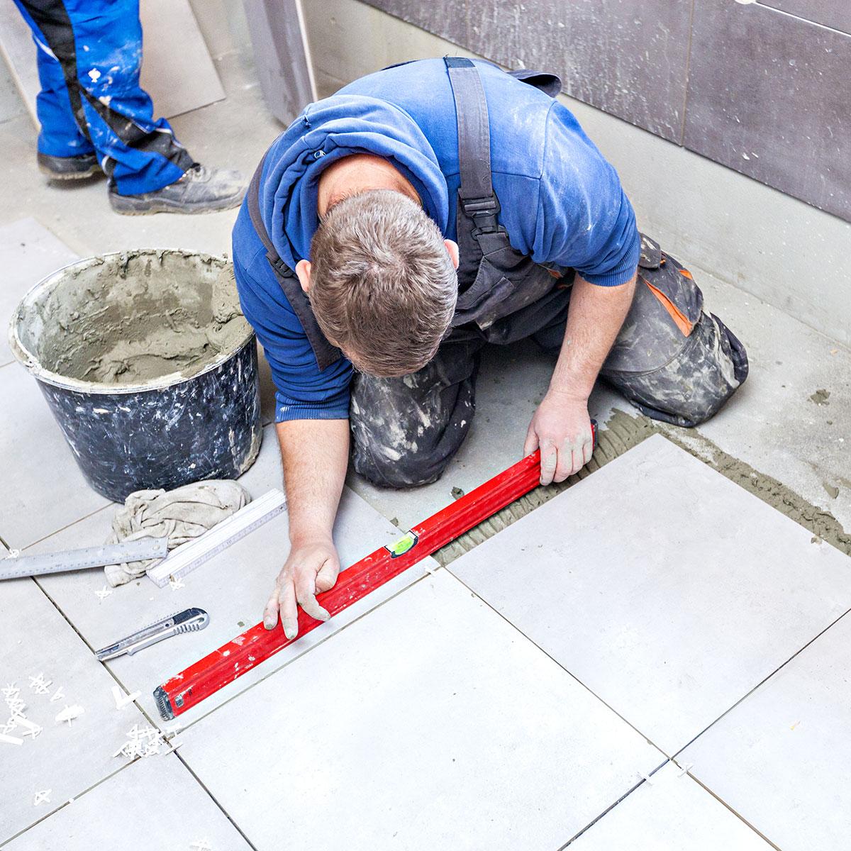 bathroom remodeler tiling bathroom floor