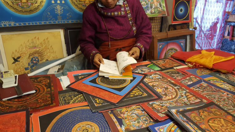 Checking out the Tibetan paintings at the Tara Art Center.