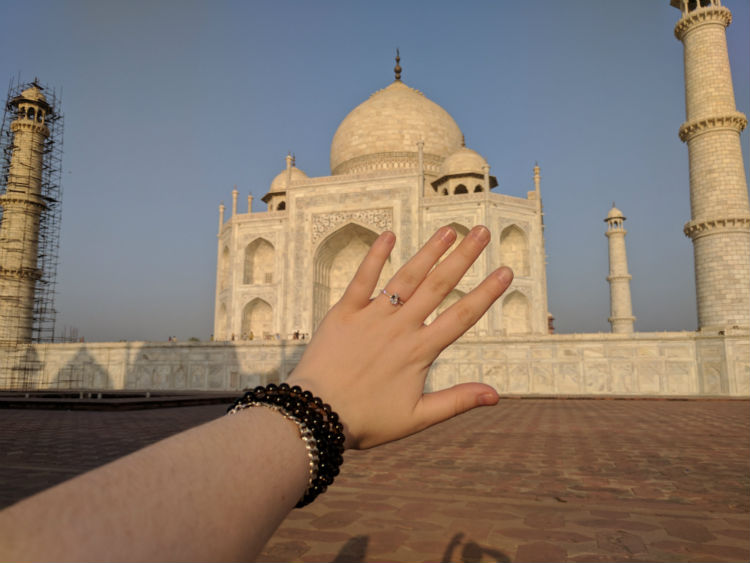 The engagement ring in front of the Taj