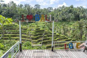 Posing in I love Bali Sign