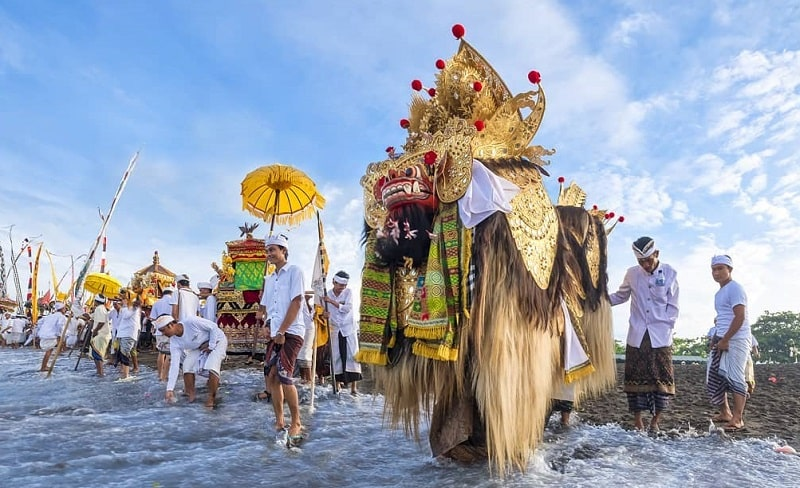 Religious ceremony called Melasti at the beach in Bali few days before Nyepi day