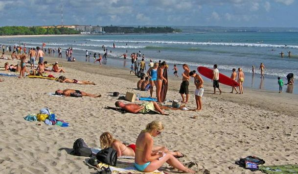 One of the beaches in Bali is crowded by tourists