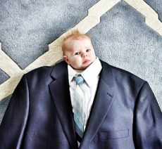 Small baby growing into a full size suit - future fitting for anticipated growth