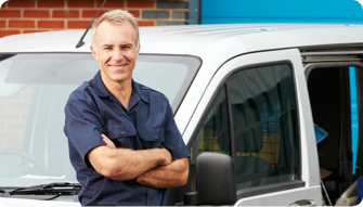 an elderly man leaning against a car