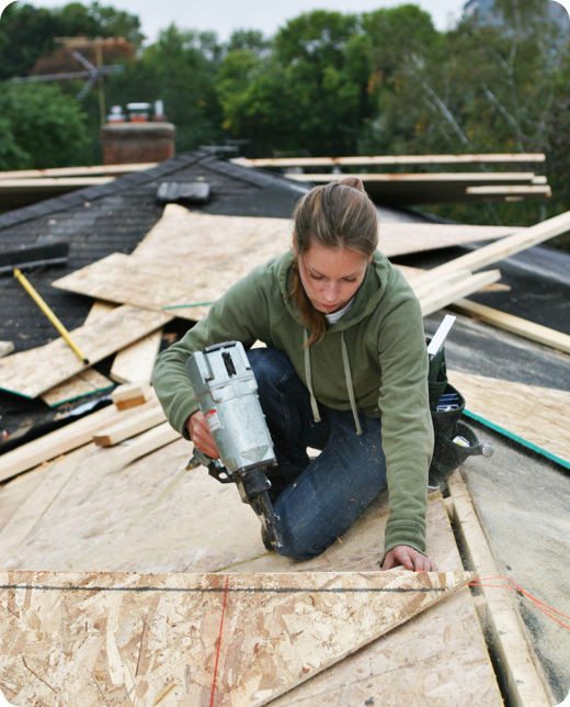 a young woman fixing a roofing issue