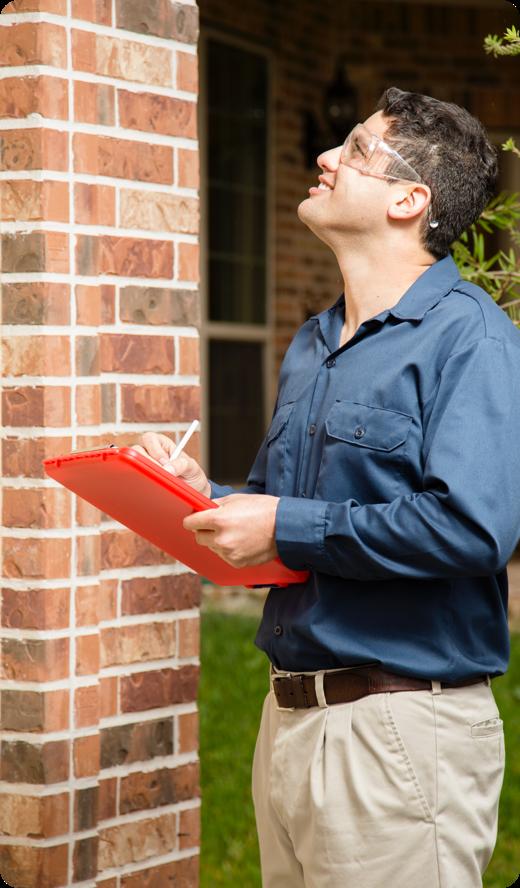 a man inspecting a house