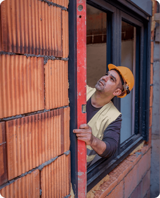 a man looking upwards from the window