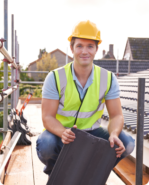 a young man holding a roofing material