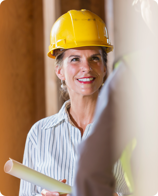 a smiling woman wearing yellow helmet